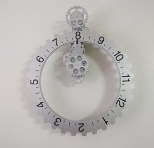 a clock where the numbers rotate rather than the hands.jpg