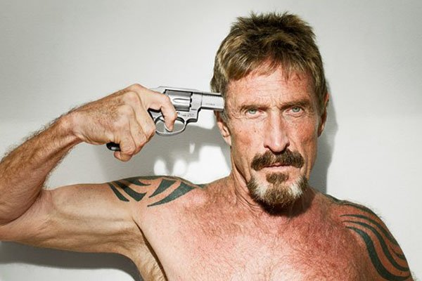 John McAfee gun to head