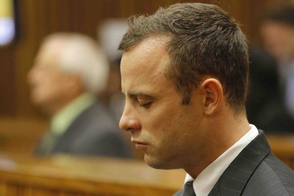 South African Paralympic athlete Oscar Pistorius is pictured in the dock during his ongoing murder trial, Pretoria, South Africa, Tuesday, 11 March 2014. Pistorius stands trial for the premeditated murder of his model girlfriend Reeva Steenkamp in February 2013. Picture: Kim Ludbrook/EPA/Pool