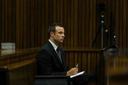 Oscar Pistorius is seen during his murder trial at the North Gauteng High Court on Tuesday, 11 March 2014.Pistorius is accused of the murder of model and law graduate Reeva Steenkamp on February 14 last year. She was shot in the arm, hip and head. He is also charged with illegal possession of a firearm and ammunition, and two counts of discharging a firearm in public. Picture: Kevin Sutherland/Times Media Group/Pool