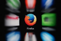 Firefox icon on mobile screen with blurred icons