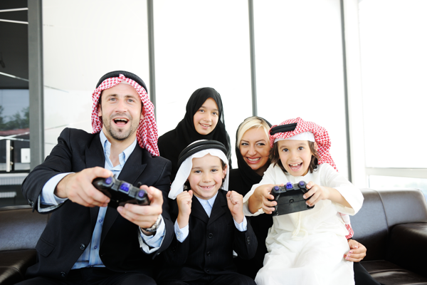 Middle Eastern video gamer family
