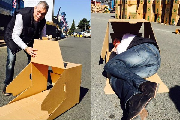 Watch South Africa's richest CEOs sleeping on the street in a cardboard box