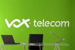 Vox Telecom logo on wall